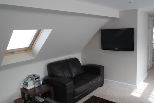 Master Bedroom with Sofa under front slope with Velux